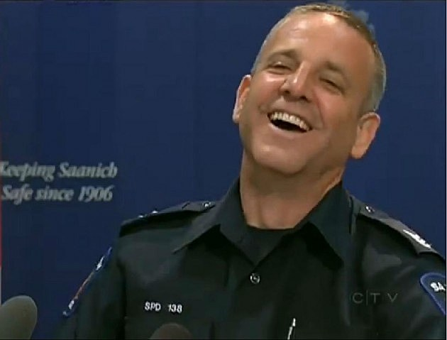 A Canadian police chief laughs at a press conference concerning stolen potato chips