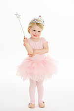 Little Girl Dressed As Fairy Against White Background