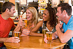 Two couples having beer together