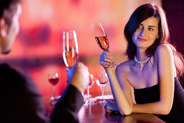 Amorous couple on romantic date or celebrating together at restaurant